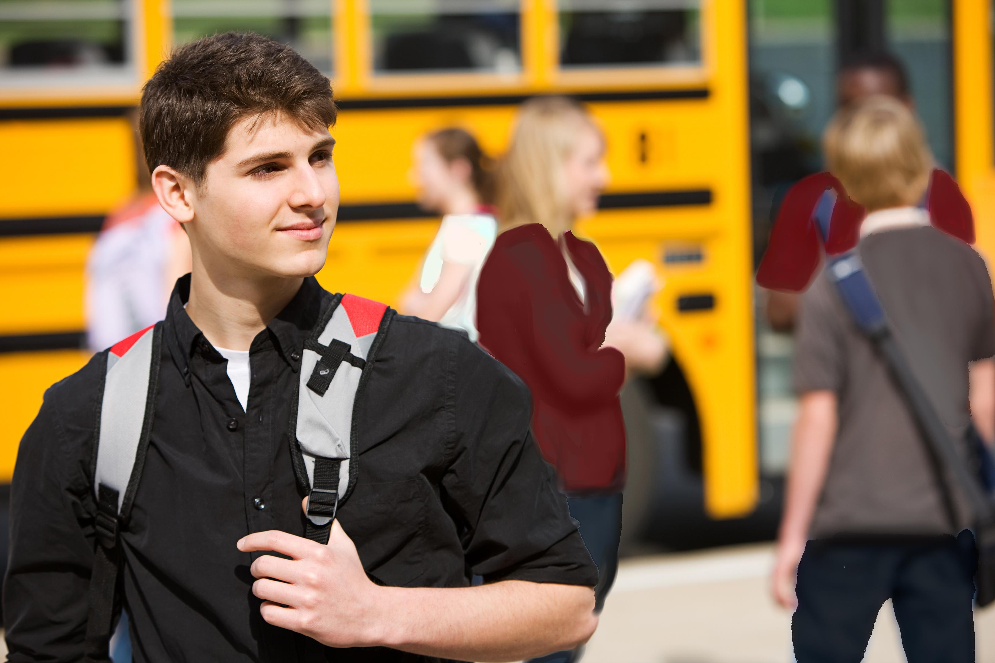 high school boy getting off bus R